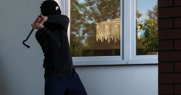 Burglar tries to smash a window in the building